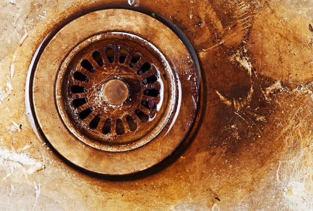 old dirty metal corroded rusty sink drain