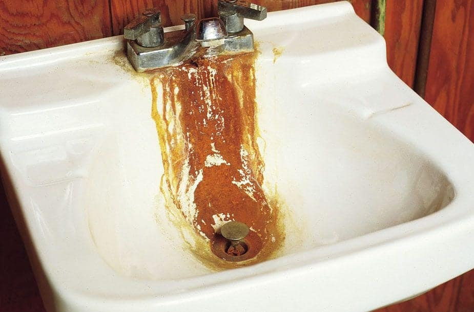 Rusty stain running from faucet to drain in bathroom sink