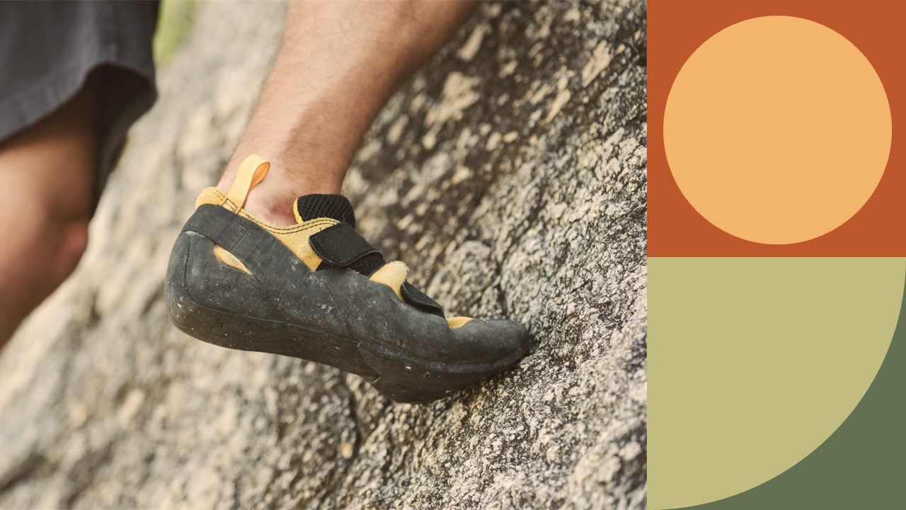 Decorative image of a rock climber that is zoomed in on their shoes.