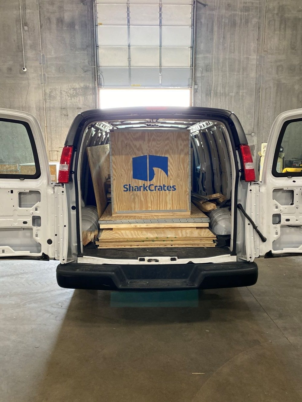 Van with wood shipping crates