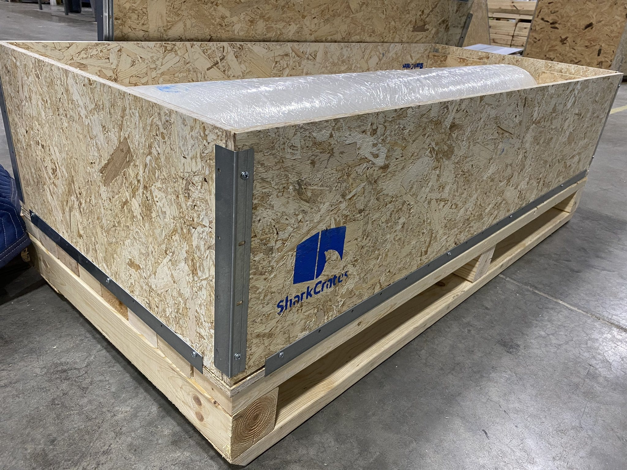 Reusable Shipping Crate with Suspended roll cylinder on heavy duty pallet